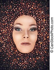 Girl immersed in coffee beans - Concept of coffee with...