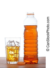 Glass and bottle of ice tea - A glass and bottle of ice tea...