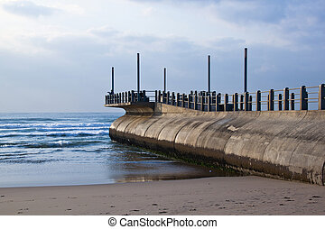 Concrete Pier Leading into Sea off Durban Beach, South...