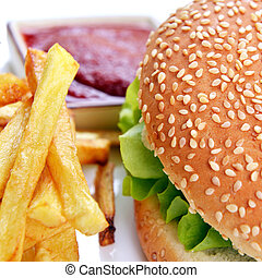 Tasty hamburger - Tasty and appetizing hamburger with fries...