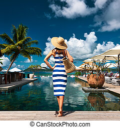Woman sailor striped in dress near poolside - Woman in...