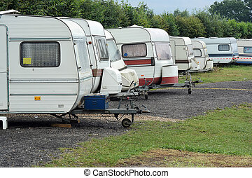 Caravans - Row of Old-fashioned caravans on a camping site...
