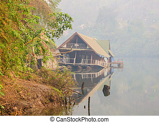 Abandoned broken home on the bank of the river