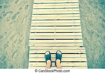 gangway - man walking in a gangway in a beach