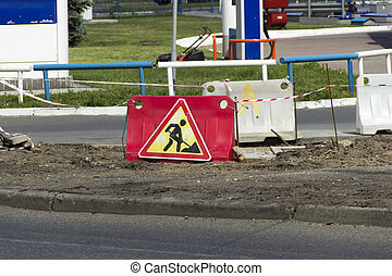 Road Working Sign - image of the men working sign next to...