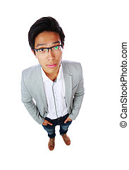 Top view portrait of a handsome asian man over white...