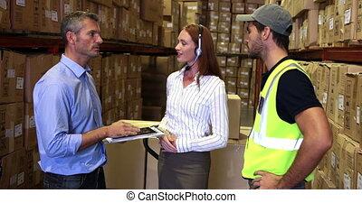 Warehouse worker talking