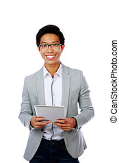 Portrait of a happy asian man holding tablet computer over...