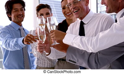 Business people toasting with champagne in slow motion