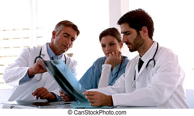 Medical team going over x-ray
