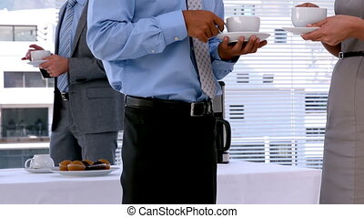 Business people standing and having coffee in slow motion