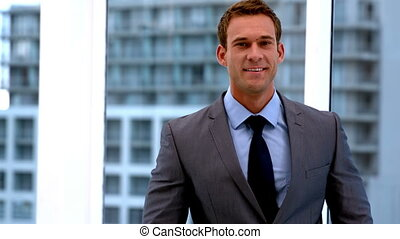 Handsome businessman smiling
