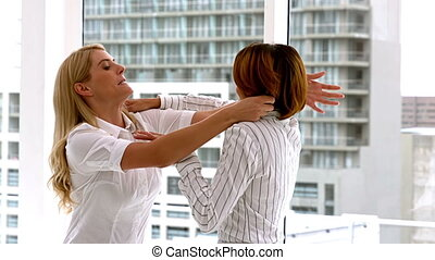 Businesswomen getting physical in a fight in slow motion