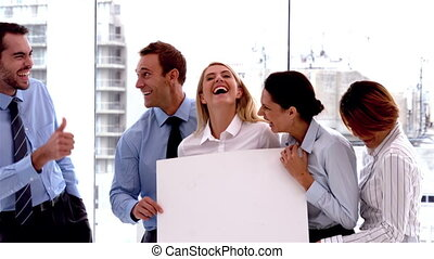 Business people laughing together - Team of business people...