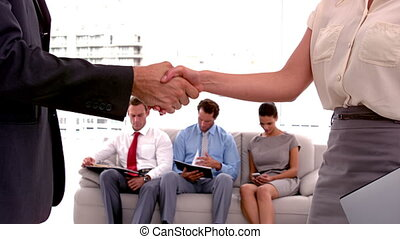 People meeting and shaking hands - Business people meeting...