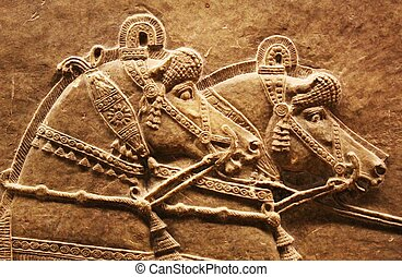 assyrian horses - stone carving