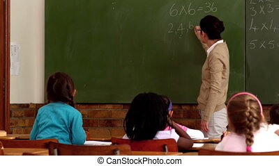 Teacher teaching math to her pupil - Teacher teaching math...