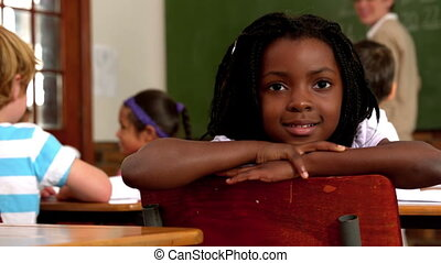 Cute little girl smiling at camera during class in slow...