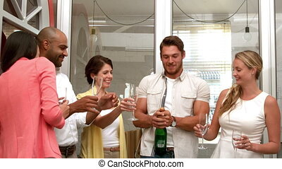 Team celebrating with champagne - Casual business team...