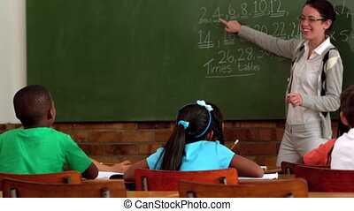 Teacher teaching math to young clas - Young teacher teaching...