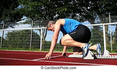sprint start in track and field in slow motion