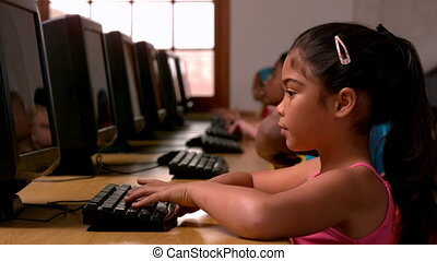 Girl using computer in classroom