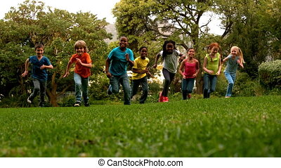 Pupils racing on the grass outside - Cute pupils racing on...