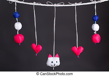beautiful multi-colored childrens soft toys on a rope...