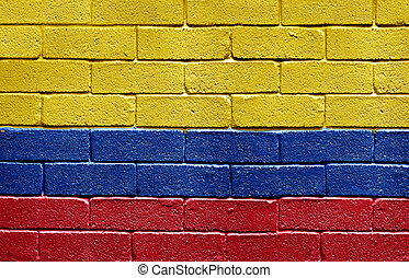 Flag of Colombia on brick wall
