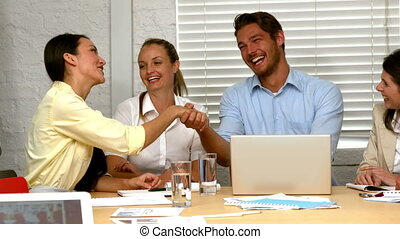 Business partners shaking hands - Casual business partners...