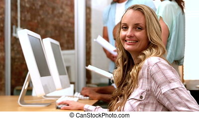 Businesswoman smiling at camera - Casual businesswoman...