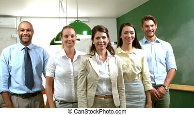 Business team showing thumbs up - Casual business team...