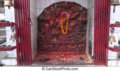 hinduism worship place altar with candles and bells in...