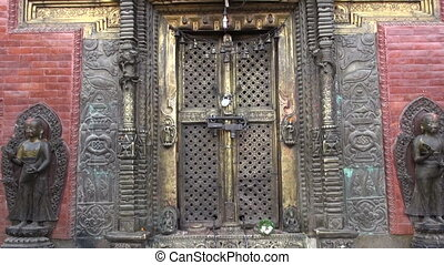 closed ornate temple in Katmandu historical old town door...