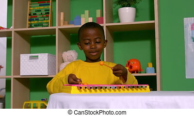 Cute little boy playing xylophone - Cute little friends...