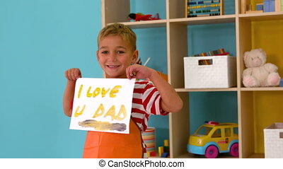 Little boy showing painting - Cute little boy showing...