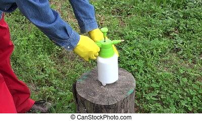 herbicide sprinkler in farmer hand - small chemistry...