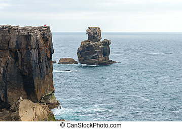 Cabo Carvoeiro near Peniche (Portugal) - Man on the cliff,...