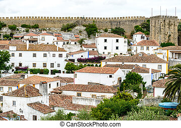 Rooftops, houses and old city wall, Obidos Portugal -...