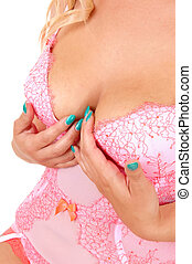 Woman in pink lingerie. - A closeup picture of the bust of a...