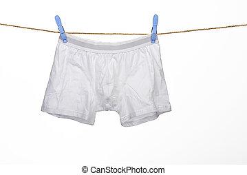 white underwear on a string against white background
