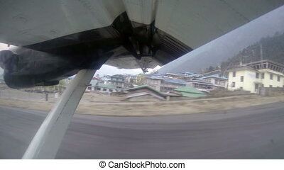27K Take off on the plane from Lukla, Nepal Airplane wing...