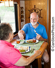 RV Seniors - Great Dinner Honey - Senior man gives his wife...