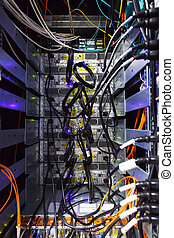 rack in the data center with working equipment with optical...