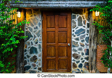 Wooden door in the evening - Front wooden door of residence,...
