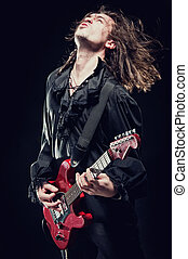 Rock-star playing a concert - Rock-star perfoming loud music...
