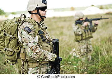 Soldier in patrol - Soldiers in full gear patrol the area in...