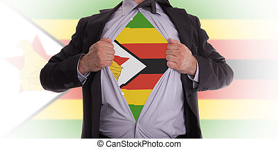 Businessman with Zimbabwe flag t-shirt - Businessman rips...