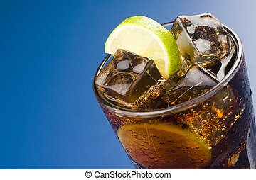 refreshing glass of cola with lemon and ice isolated