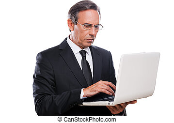 Businessman at work Confident mature man in formalwear...